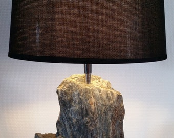 Table lamp with a natural stone foot.