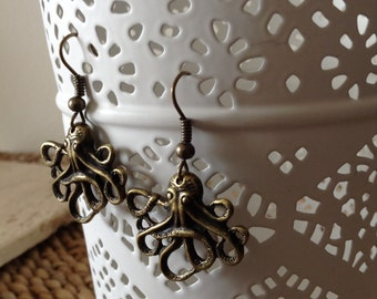 Simple and fun brass Octopus dangle earrings.