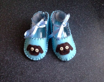 Baby boys blue felt booties with dog applique,pale blue ribbon ties.