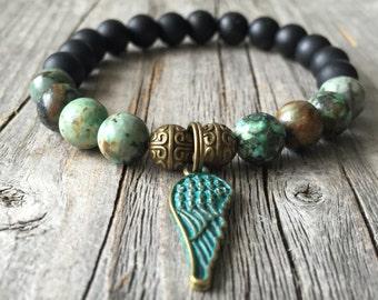 Woman gemstone bracelet, beaded wanderlust bracelet, bracelet with wing, stretch stacking bracelet, Woman gemstone jewelery, woman gift idea