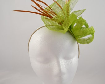 Green fascinator with feather embellishment