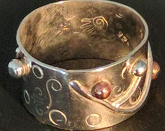 Sterling silver and copper stamped vine ring.