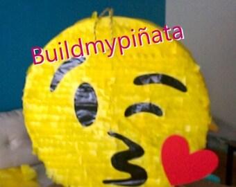 "Emoji piñata, 26"" in diameter."