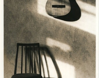 guitar&chair.silver gelatin print,sepia toned