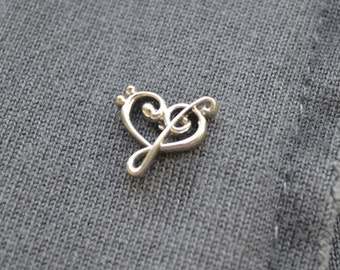 jacket pin with treble clef and bass clef in Silver 925%