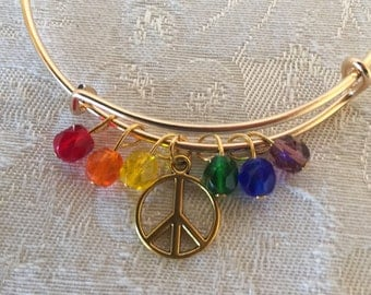Peace Sign Charm And Crystal Adjustable Wire Bangle Bracelet Gold Tone