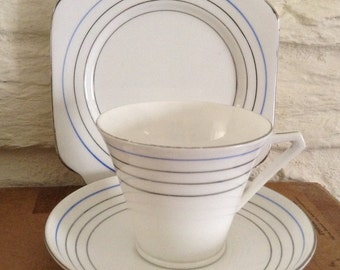 Art Deco trio cup and saucer with side plate.