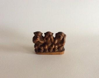 Three wise monkeys, see no evil, hear no evil, speak no evil. Small wooden item, handcarved
