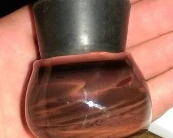 red glass jar