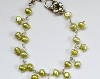 Freshwater pearl bracelet, lime green with silver daisy clasp