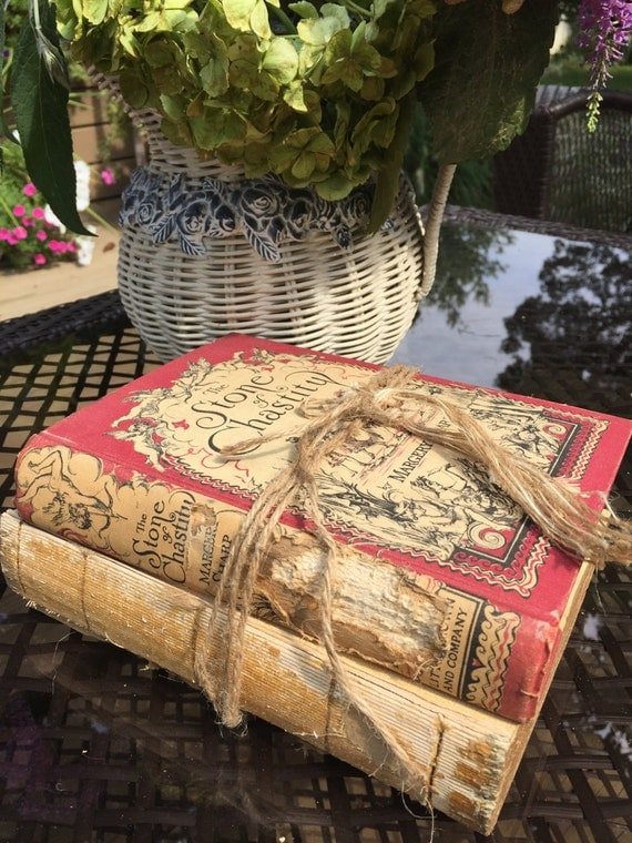 Old tattered book stack book decor antique book stack for Antique books for decoration