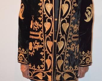 Royal black velvet and gold metal braded coat.