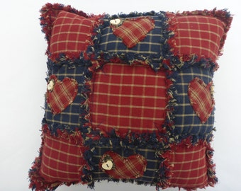 Homespun patchwork cushion. Shabby chic appliqué hearts and button detailing.