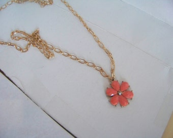 Necklace with a Coral-colored Flower Pendant with a Gold Colored Chain
