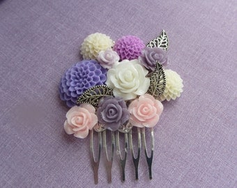 Floral head comb Ideal for the wedding party, proms or any special occasion. On small Silver coloured comb with silver coloured leaves