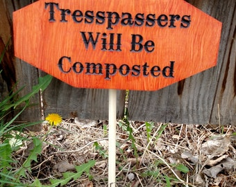 Composted Trespassers garden sign