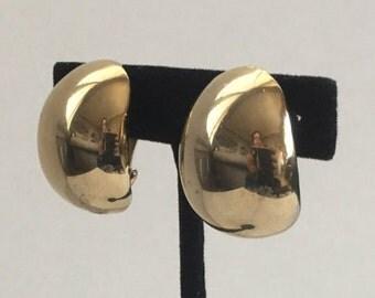 Bold gold tone clip on earrings, vintage earrings