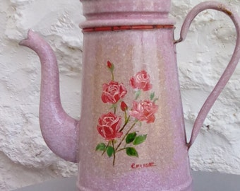 Pink enamel French cafetière coffee pot.