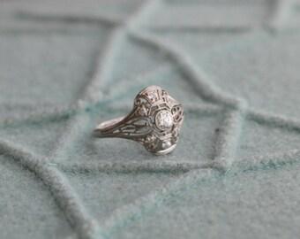 1920s Edwardian Platinum and Diamond Domed Filigree Engagement Ring
