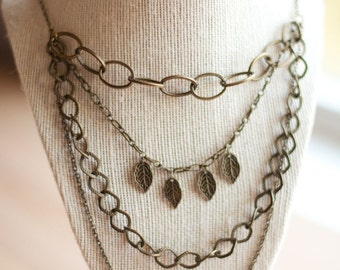Multi Chain Layered Antique Brass Necklace with Leaf Details