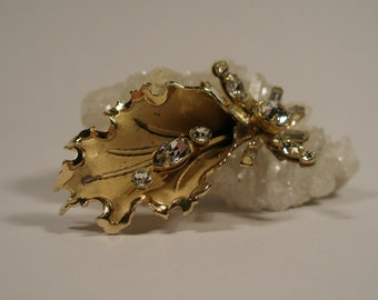 Vintage gold tone leaf with sprig and rhinestone brooch