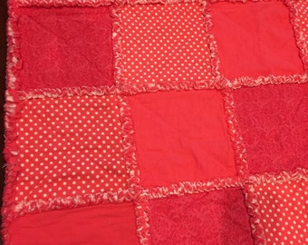 "Bright Coral Rag Quilt. Reversible, soft cozy flannel.  44"" x 52"""