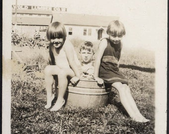 vintage photo 1930 Children Swimsuits in Metal Bucket in the Yard