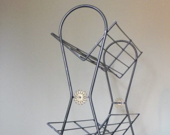 Vintage mid century modern black rack stand book shelf bookstand use for towels or linen metal three tiers - atomic flower swirly legs
