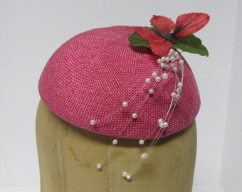 Lipstick pink button hat made from fine parasisal straw.