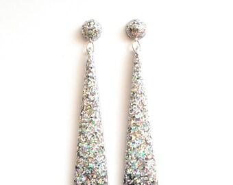 Handmade Triangle Drop Earrings. Large long chandelier facet geometric statement dangle resin earrings in hologram silver glitter.