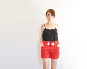 real deal mickey mouse shorts . mouse tail . huge buttons . etc .small.medium