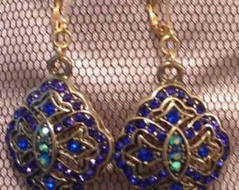 Blue stone earrings in gold setting
