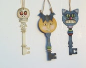 "Hand Painted Halloween ""Key"" Ornaments    Moon with Bat, Skeleton, Cat Face ."