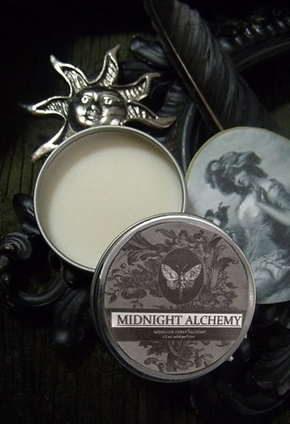 Midnight Alchemy Natural Solid Perfume Gypsy Apothecary Patchouli, Dragons Blood,Cassia, Rosemary,Almond,Orange,Elderberries.
