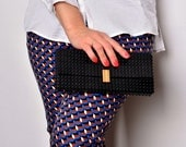Black clutch with real gold plated elements made entirely of LEGO bricks