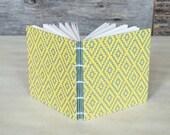 Handmade notebook with yellow and gray diamond pattern