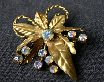 Beautiful vintage golden leaf and rhinestones brooch.