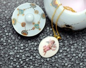 Porcelain necklace, white with cherub
