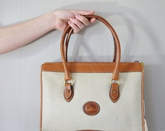 Vintage Larger Size Dooney & Bourke All Weather Leather Bag | British Tan and Cream | Pebbled Leather