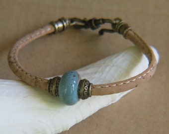 Round beige stitched  leather Bracelet - Teal porclean bead with goldtone accent beads -  Goldtone hook clasp