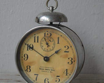 Antique Advertising Alarm Clock