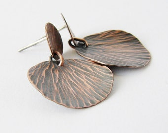 Rustic copper patina earrings. Textured bohemian drop stud earrings. Copper and silver posts.