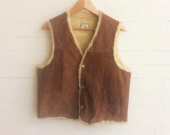 SALE  Vintage suede vest . sheepskin vest . 1970s vest . Size small / medium