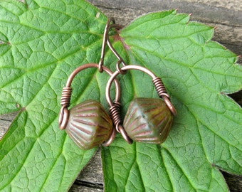 Green tribal earrings - rustic bicone Picasso glass copper wire wrapped