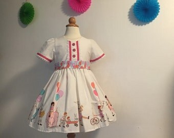 "Fancy cotton ""Children at Play"" little girls party dress with attached ""balloon"" sash and pink sparkle buttons, size 2T"