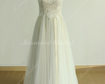 Flowy tulle lace wedding dress with illusion neckline and champgane lining