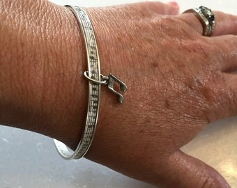 Silver bangle with sheet music inlay & pewter charm