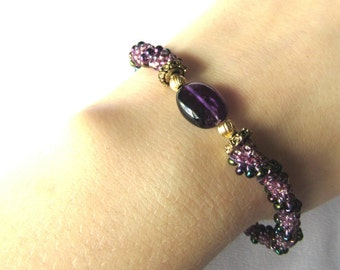 Beaded bracelet, four purple glass beads, hand strung, hand crocheted, flat amethyst bean, pewter bead caps, 12k goldfilled beads, 7-8 inch.