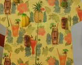 Wall-Hanging Hawaiian Shirt with Drink Recipes and Tiki-Related Magnets
