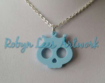 Small Cute Pale Powder Blue Skull with Tiara Crown Laser Cut Charm Necklace on Silver or Gold Crossed Chain or Black Faux Suede Cord